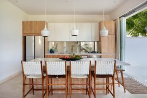 Fully equipped kitchen with bench seating and cow hide upholstered stools