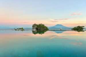 Looking across the infinity pool at 353 Degrees North out to Mount Agung on Bali