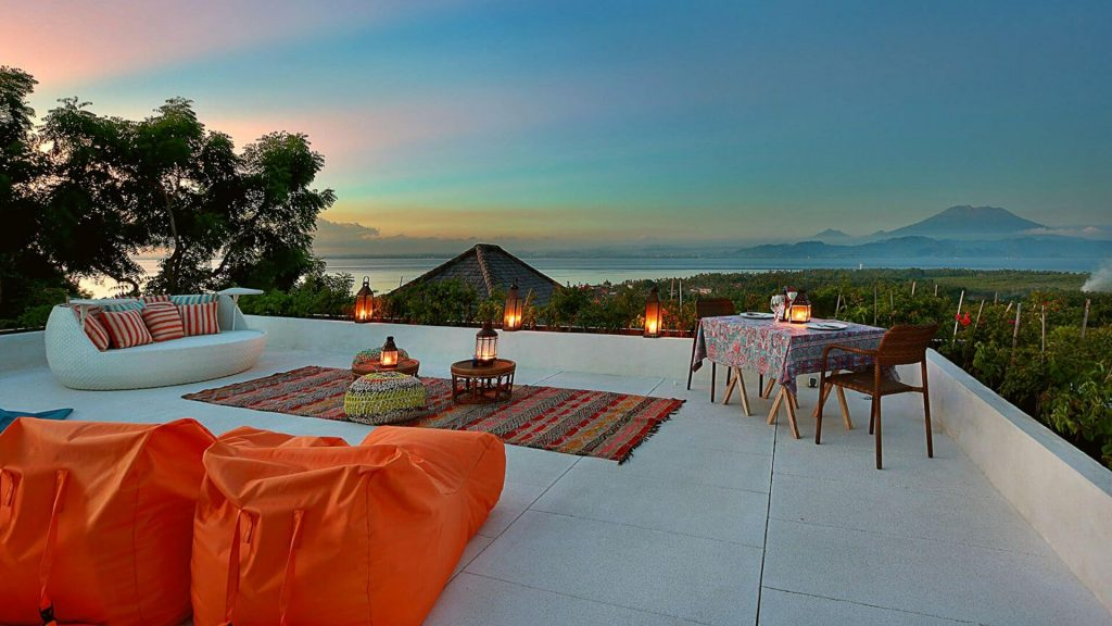 Rooftop terrace at Villa 353 Degrees North on Nusa Lembongan showcasing lounge set up and bean bags to enjoy those sunset views and of Mount Agung on Bali