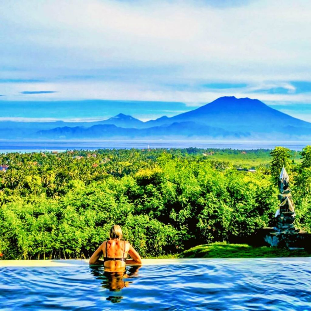 #BookDirect For A Cheaper Vacation - Looking out to Mount Agung on Bali from the infinity pool at VILLA 353 DEGREES NORTH ON NUSA LEMBONGAN AN ISLAND IN INDONESIA
