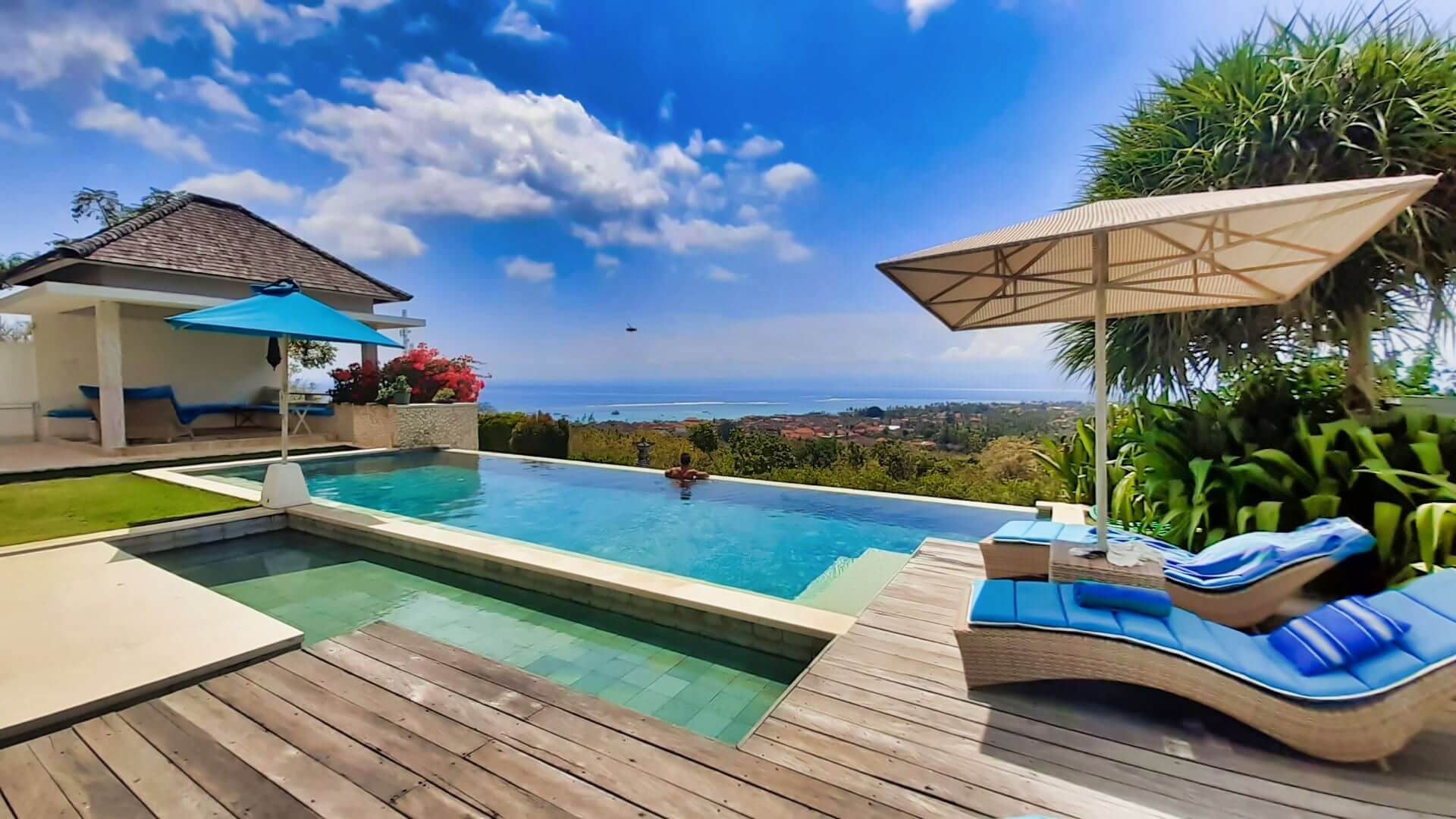 COVID-19 UPDATE - LOOKING ACROSS INFINITY POOL AND JUNGUT BATU BAY TO BALI FROM VILLA 353 DEGREES NORTH ON NUSA LEMBONGAN, BALI