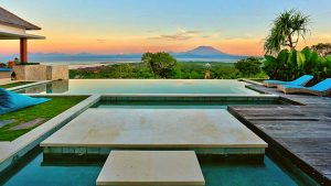 SUNRISE ACROSS INFINITY POOL LOOKING OUT TO MOUNT AGUNG ON BALI